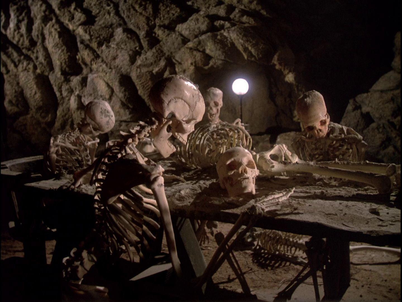 Skeleton Sitting At Desk Behind the skeletons is one of
